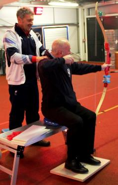 Dave McCullogh receiving training on disability coaching from Tim Hazell, Head Coach for  Paralympic Archery at London 2012